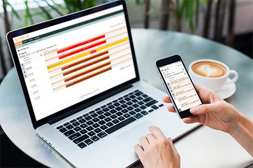 Personeelsplanning app Symagic op telefoon en laptop